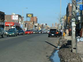 Danforth Avenue, Toronto, East of Pape Ave: same day, same time. No Cars? Watch out, you\'re about to be hit by one!